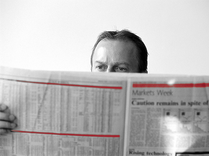 man_behind_newspaper_4-3.jpg