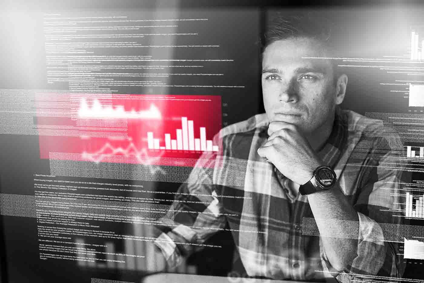 Guy looking at information on screen | Atradius